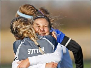 Anthony Wayne senior Allana Bell hugs senior Erika Sutton after the Lady Generals won Saturday's district final match up against Notre Dame Academy.