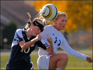 Notre Dame Academy freshman Halee Roberts, left, fights Anthony Wayne junior Jessie Mattimoe for the header during the first half.