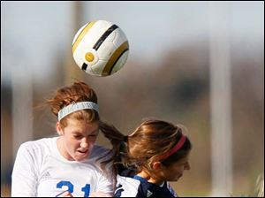 Anthony Wayne junior Sarah Petrell gets the header during the first half.