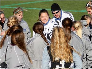 Anthony Wanye head coach Lori Williams, center, talks with her team after winning Saturday's district final.