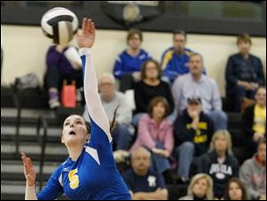 St. Ursula's Katie McKernan (5) spikes the ball against  Notre Dame.