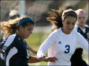 Notre Dame Academy's junior Natalie Deeb fights for control of the ball against Anthony Wayne's sophomore Abby Allen
