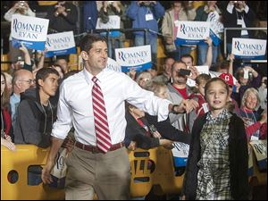 Republican vice presidential candidate Paul Ryan greets the crowd with his daughter Liza before a rally Saturday in New Philadelphia, Ohio.