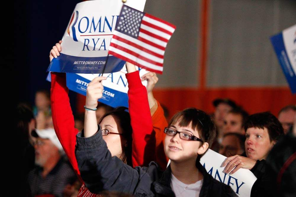 Supporters-hold-flags-for-Republican-presidential