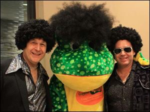 From left, Gary Ross, Frogtown Frog, Todd Gagne at the Frogtowndeals.com disco bash.