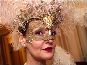 Condessa Croninger wears an elaborate mask to the Blue Moon Ball.