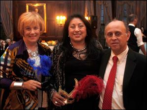 From left, Kathy Jones, Yolanda and E. Tomas Calderon at the Blue Moon Ball.