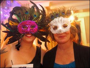 Kristy Becker, left, and Ellen Pfaff donned elegant maskes for the evening at the Blue Moon Ball.