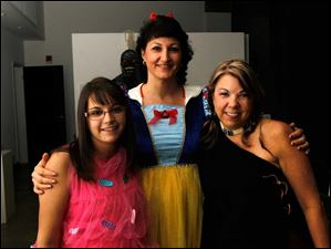 Dressed as a cupcake, Snow White and Sacagawea, are from left, Judi Burkhart, Brenda Kennedy of Maumee, and Shelly Burkhart. The Burkharts are both of Waterville