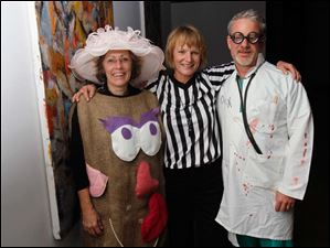 From left, Mary Wright with Nan and Tim Borer at the Bone Bash to benefit the Arthritis Foundation at the Secor Building.