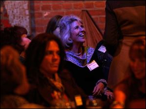 Carla Smith of Ottawa Lake, Mich., smiles during Fashion for a Cause at Treo.