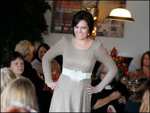 A model shows off a champagne colored dress at Treo Restaurant.