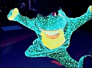 The Frogtown Deals frog shows off his disco moves at the  Disco Bash, a benefit for Maumee Valley Habitat for Humanity.