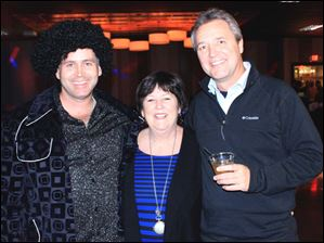 From left, Todd Gagne, Tina Skeldon Wozniak, Russ Wozniak at the Disco Bash.