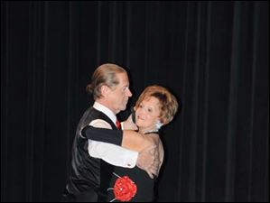 Len Hansen leads his wife Paula, as they compete for the Dance Uncorked trophy.