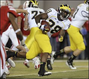Michigan's Fitzgerald Toussaint carries the ball against Nebraska.