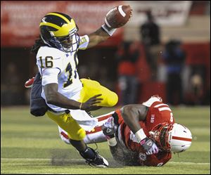 Michigan quarterback Denard Robinson was not part of coach Brady Hokes trickery packages this week.