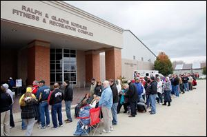 The crowd waiting to see Mitt Romney and Paul Ryan snakes around the University of Findlay's Koehler Fitness & Recreation Complex. The stop was part of the 'Victory In Ohio' bus tour.