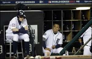 Miguel Cabrera watches from the dugout during the ninth inning of Game 3 of baseball's World Series against the San Francisco Giants Saturday in Detroit.