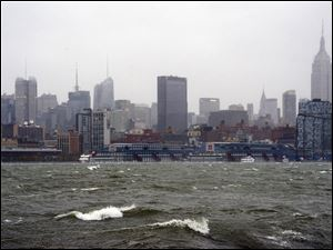 The New York City skyline and Hudson River are seen from Hoboken, N.J., as Hurricane Sandy approaches on Monday.