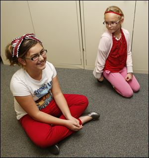 Eagle Point Elementary fourth graders, left,  Abby Britton-Lowden, 10, and Julie Siewert, 10, talk about letters they wrote to  Vietnam veterans who took a recent Honor Flight in Rossford, Ohio.