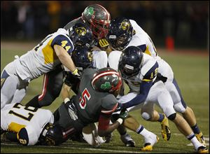 The Whitmer defense shuts down Central Catholic's Paul Moses on Friday night. Whitmer won 42-