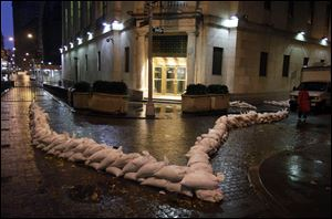 Sand bags protect an entrance of the New York Stock Exchange early Monday.