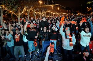 San Francisco Giants fans celebrate outside San Francisco's City Hall while watching a broadcast of the Giants facing the Detroit Tigers in Game 4 of the World Series.