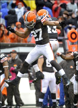 Cleveland Browns safety Eric Hagg (27) and T.J. Ward celebrate after stopping the San Diego Chargers on fourth down in the final seconds of a 7-6 win by the Browns on Sunday in Cleveland.