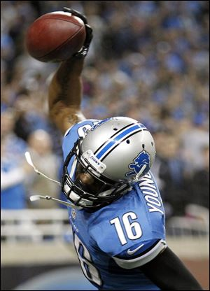 Detroit Lions wide receiver Titus Young spikes the ball after scoring the game-winning touchdown with 20 seconds left against the Seattle Seahawks on Sunday in Detroit. The Lions won 28-24.