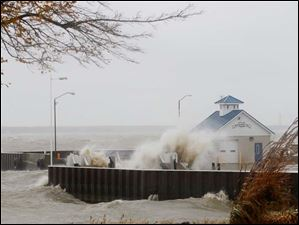 Waves crash over the Miller Boat Line on Catawba Island Monday.