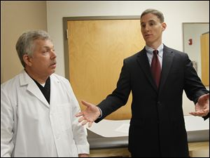 State treasurer Josh Mandel, Republican candidate for U.S. Senate, discusses his 10-point healthcare reform plan with Sylvania Township podiatrist Dr. Bruce Saferin.