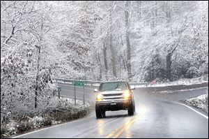 Snow sticking to tree limbs on Grandview Road in Beckley, V.Va. as superstorm Sandy wheeled toward land Monday.