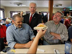 Vice President Joe Biden gets a piece of custard pie from Diane Haffen during a campaign stop at Schmucker's restaurant in Toledo.