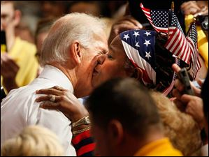 Vice President Joe Biden is given a kiss after speaking at the University of Toledo Oct. 23, 2012.