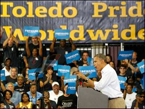 President Obama speaks to a crowd gathered at  Scott High School as part of his