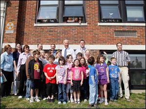 Vice President Joe Biden visits students outside Glenwood School, in the Rossford School District, in Rossford March 15, 2012.