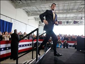 Republican vice-presidential candidate Paul Ryan takes the stage during a campaign rally in a Grand Aire hangar at Toledo Express Airport, Oct. 8.