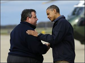 President Obama is greeted by New Jersey Gov. Chris Christie upon his arrival at Atlantic City International Airport, Wednesday.
