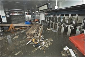 Employees from MTA New York City Transit work to restore the South Ferry subway station after it was flooded by seawater during superstorm Sandy.