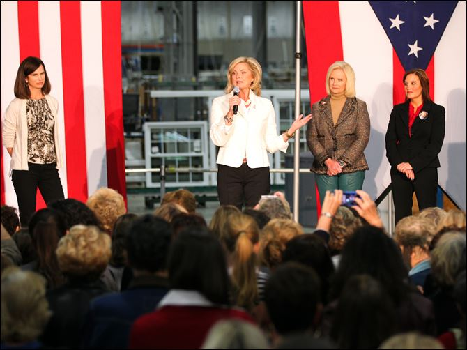 Ann Romney, wife of Republican presidential candidate Mitt Romney, speaks during a campaign stop Wednesday at Vinylmax in Hamilton, Ohio. Joining her on stage, from left, Jane Dudley Portman, wife of Ohio senator Rob Portman, Cindy McCain, wife of Arizona senator John McCain, and Ohio Lt. Gov. Mary Taylor.