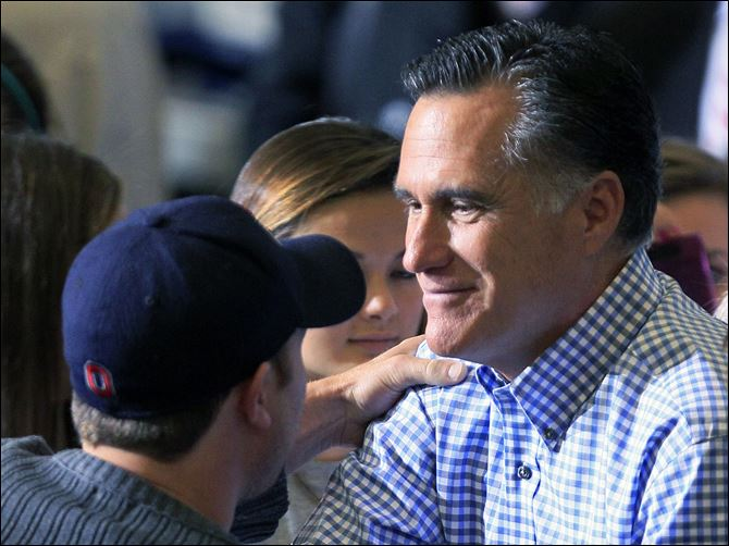 Romney 2012 Kettering Ohio Republican presidential candidate Mitt Romney shakes hands with a supporter while collecting donations at a storm relief event, Tuesday at James S. Trent Arena in Kettering, Ohio.