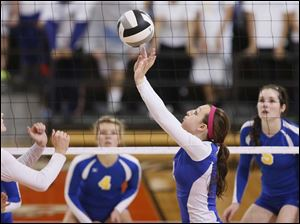 Findlay's Lindsay George (2) sets the ball against St. Ursula.