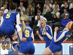 St. Ursula's Katie McKernan (5), Emily Lydey (9), Maddie Burnham (19), and Lauran Graves (8) celebrate after defeating Findlay.