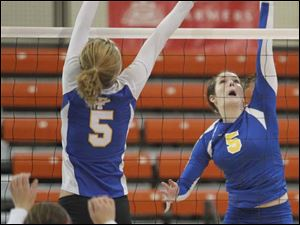 St. Ursula's Katie McKernan (5) spikes the ball against  Findlay's Ciara Ralston (5) during a Division I volleyball regional semifinal at the Stroh Center in Bowling Green. St. Ursula won in three sets.