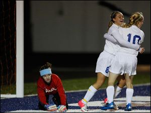 St. Ursula's Jordyn Greer (8) celebrates scoring a goal with teammate Grace Donnelly (10).