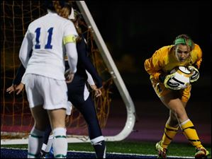 St. Ursula goalie Sydney Yeager makes another stop against Akron Archbishop Hoban.