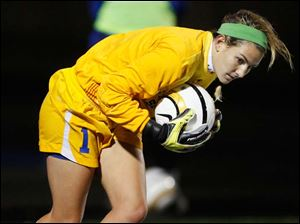 St. Ursula goalie Sydney Yeager makes a stop.