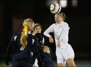 St. Ursula's Morgan Swerlein (3) tries to move the ball with a header.