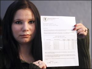 "Danielle ""Embyr"" Lindner holds a letter she received that is supposedly an ""audit"" of her voting history.."